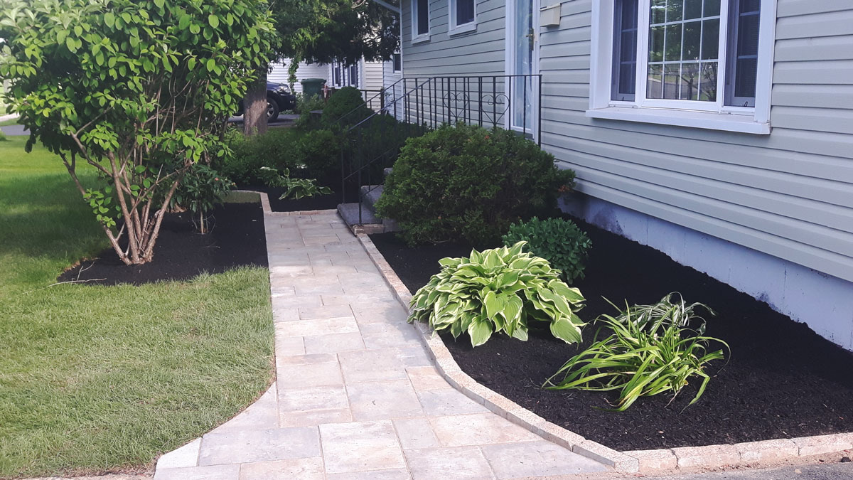 Nashwaaksis walkway, retaining wall, and bedding by Yards Apart Landscape & Design: photo 1